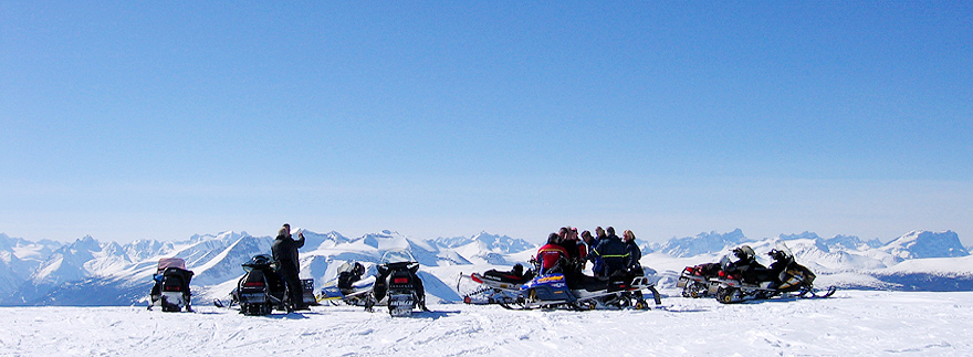Snowmobilers overlooking Turner Lake Chain from Trumpeter Mountain.