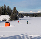 A family ice fish around their tent set up on Nimpo Lake.